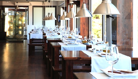 inner vista of modern restaurant whith tables and glass