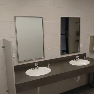newly-remodeled-grey-bathroom-with-double-sinks