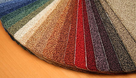 Color samples of carpet coverings in shop