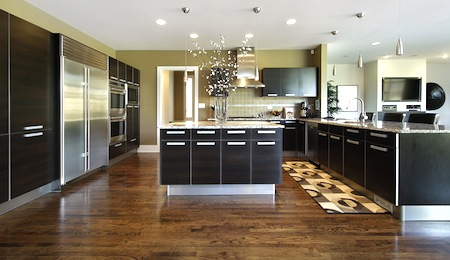 Kitchen in luxury home with dark cabinetry