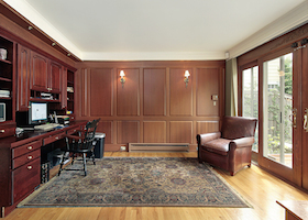 Library and office in luxury home with cherry wood paneling
