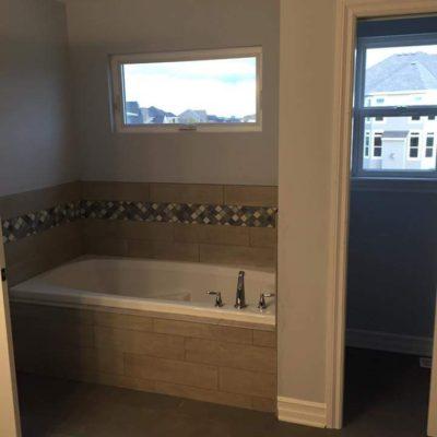 Bath Tub with Decorative Tile Backsplash