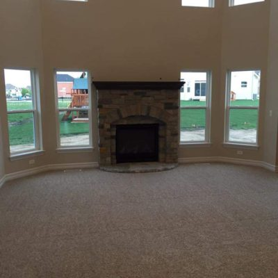 Carpeted Living Room with Stone Fireplace