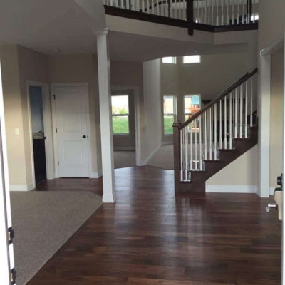 Dark Wood Flooring and Carpeting Throughout House