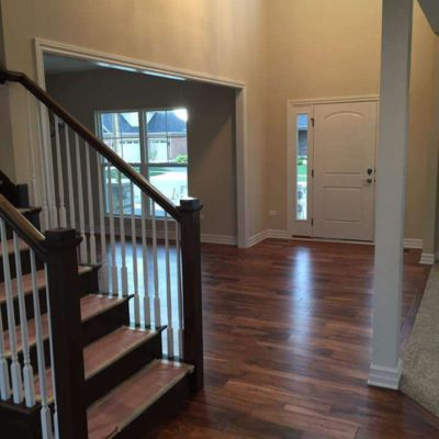 Foyer of Home with Dark Hardwood Flooring