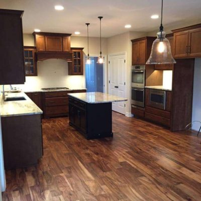 Rustic Kitchen with Hardwood Flooring and Marble Island