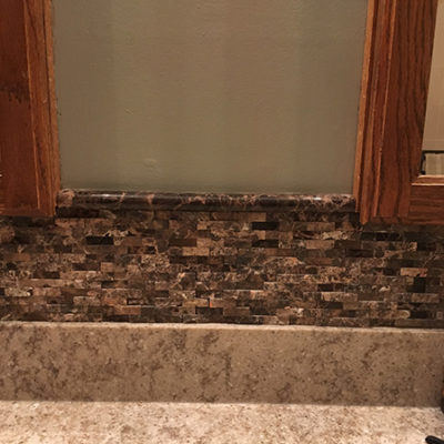 Stone Accent trim above marble countertop - Duncan Flooring Residential Project